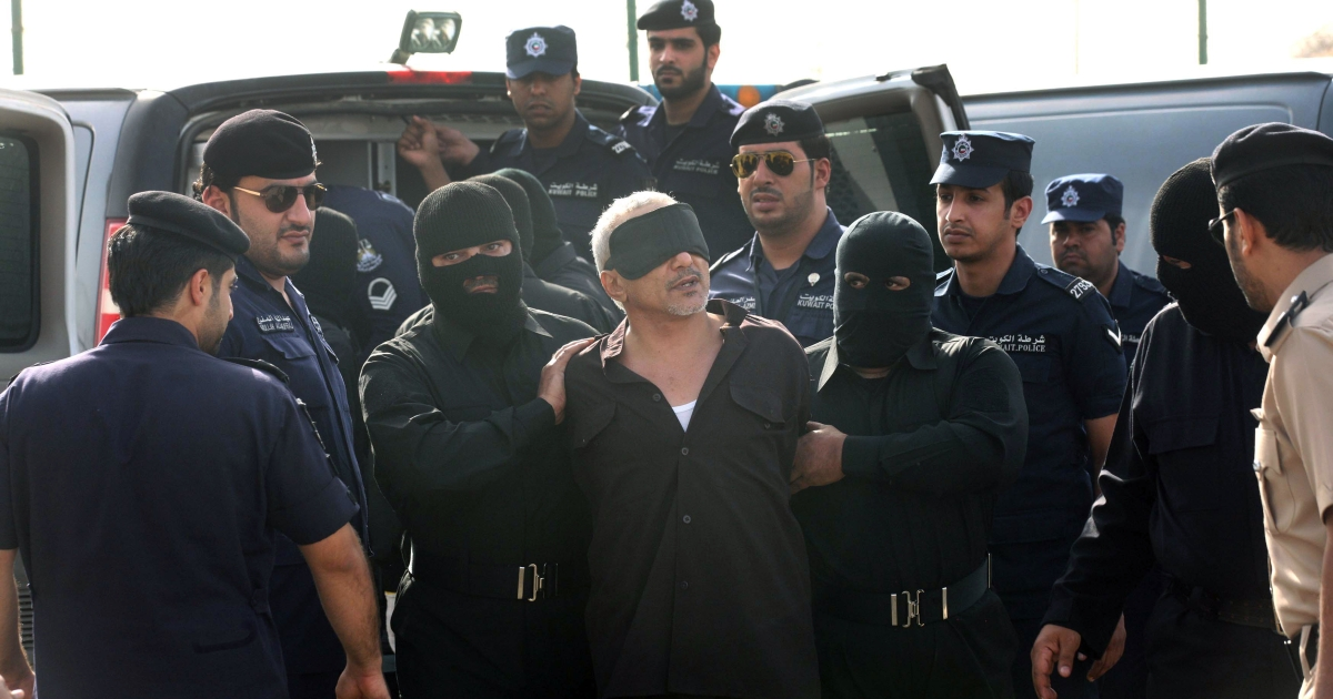 A stateless Arab is escorted to the gallows for killing his wife and five children after claiming he was a long-awaited imam, west of the capital Kuwait City, on April 1,2013. Authorities in Kuwait hanged three convicted murderers, a Pakistani, a Saudi and a stateless Arab, in the first executions in the Gulf state since May 2007, the ministry of justice said.</p>