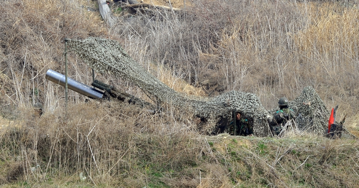 South Korean soldiers man a cannon at a military training field in the border city of Paju on April 4, 2013.</p>