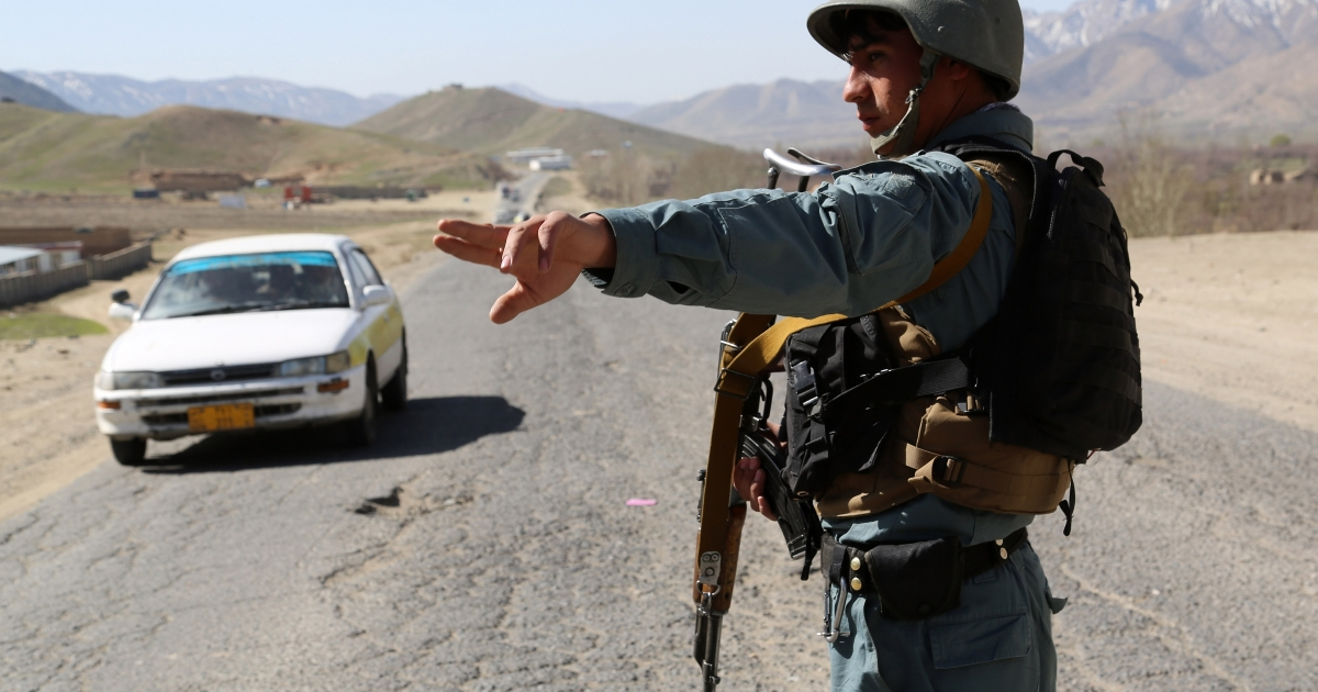 Pierre Borghi, a 29-year-old French freelance photographer, escaped his Taliban captors this week after four months of captivity. Above an Afghan policeman directs a vehicle at a checkpoint in Wardak province on April 4, 2013.</p>