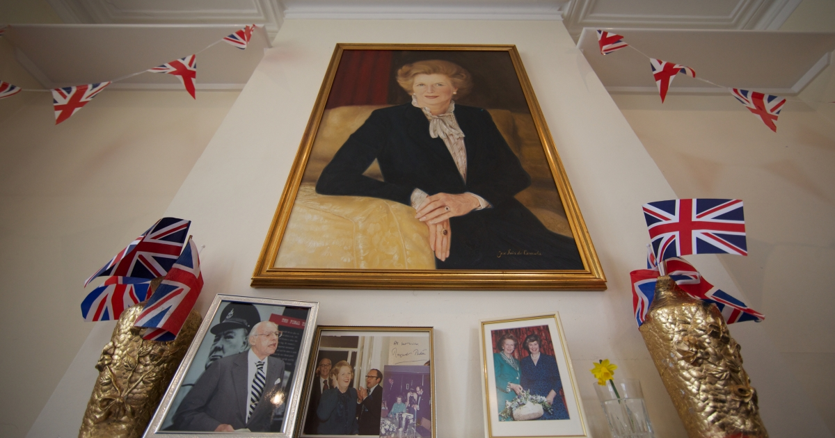 A portrait of former British prime minister Margaret Thatcher hangs on the wall at the Conservative Party headquarters in Finchley in north London on April 10, 2013. British lawmakers interrupted their holidays for a special session of parliament on April 10 to pay tribute to Margaret Thatcher, who died on April 8 at the age of 87 after suffering a stroke.</p>