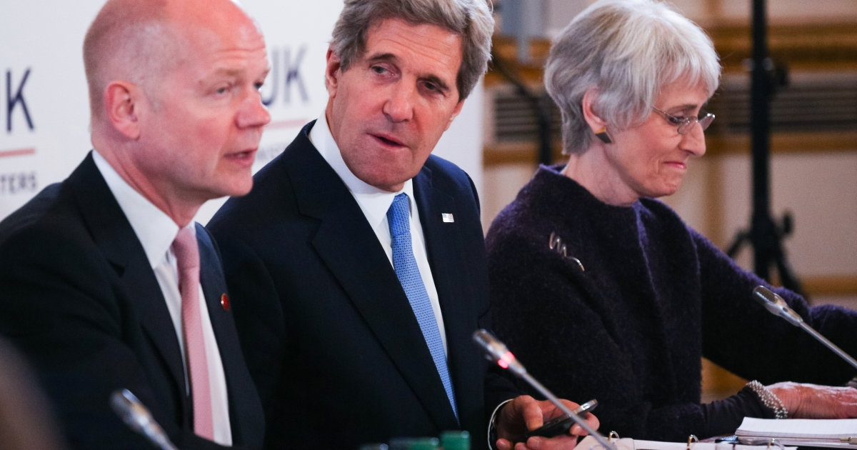 British Foreign Secretary William Hague (L) sits next to US Secretary of State John Kerry (C) during the opening session of the G8 Foreign Ministers meeting at Lancaster House in London on April 11, 2013.</p>