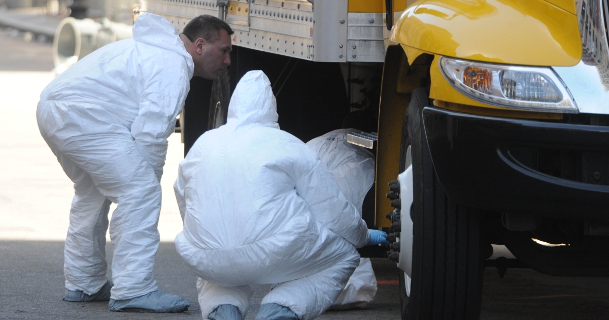 FBI crime scene investigators search a truck left on Boylston Street just past Berkeley Street April 17, 2013 in Boston, Massachusetts. Investigators continue to work the scene of two bomb explosions at the finish line of the marathon that killed 3 people and injured over one hundred more.</p>