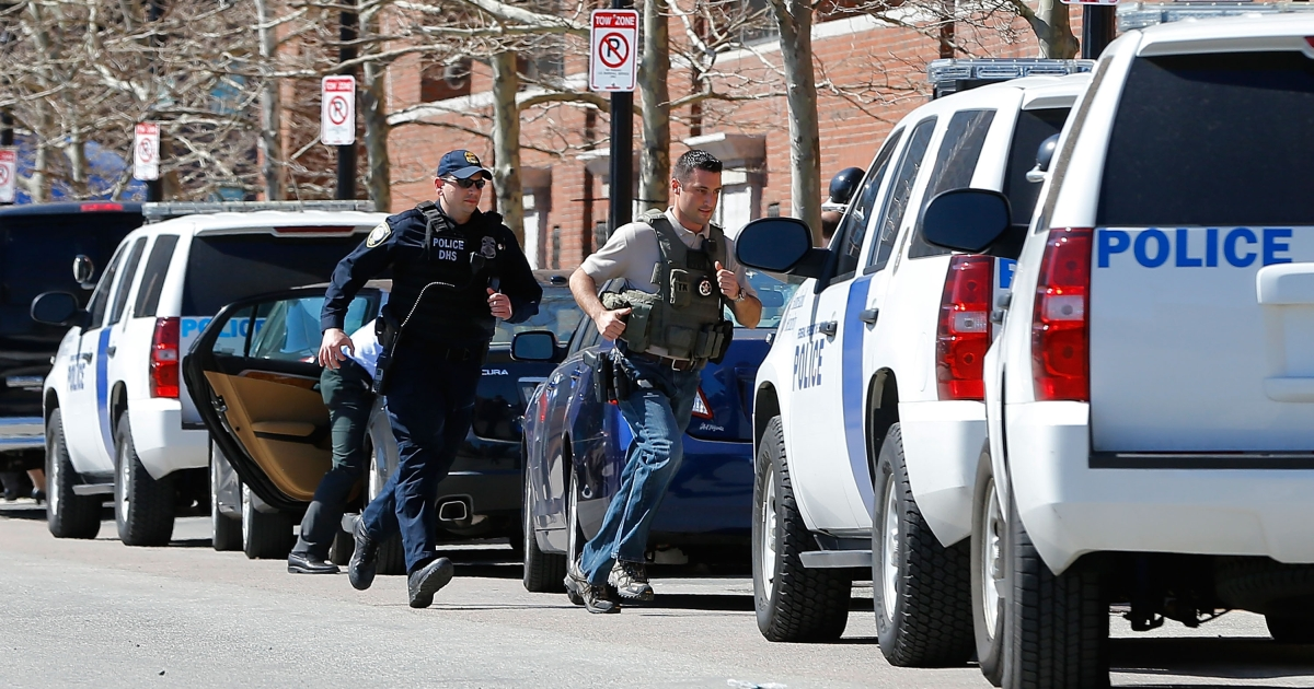 Homeland Security, US Marshals, and the Boston Police Department usher people out of the federal courthouse on April 17, 2013 at John Joseph Moakley United States Courthouse in Boston, Massachusetts.</p>