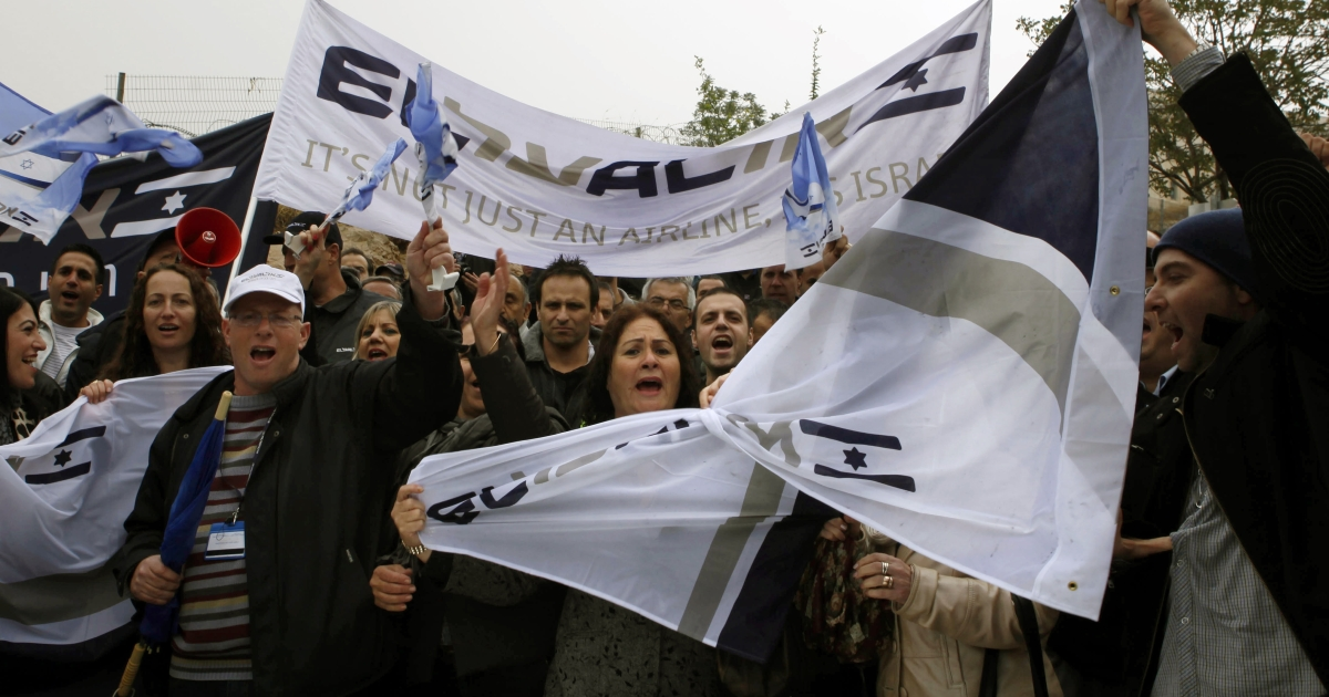 Israeli airlines workers shout slogans during a demonstration outside the prime minister's office on April 21, 2013 in Jerusalem as staff mounted a strike in protest against plans to ink an Open Skies deal with European carriers. Israel's three airlines -- El Al, Arkia and Israir -- are bitterly opposed to the deal which was to be ratified by the cabinet on Sunday, saying it would result in widespread layoffs.</p>