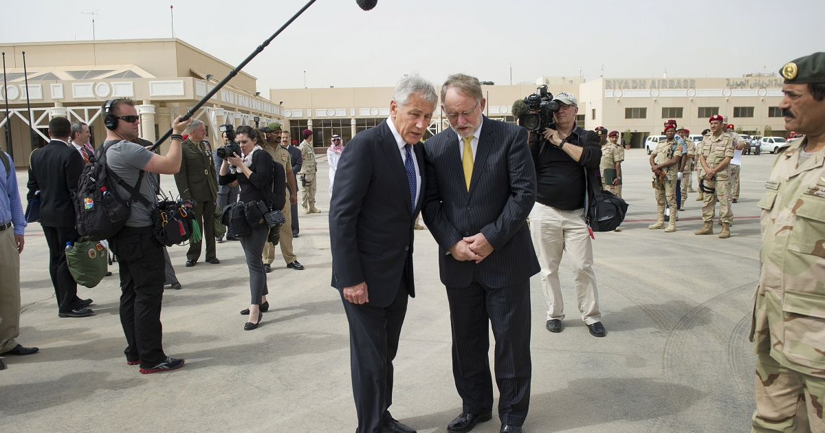 US Secretary of Defense Chuck Hagel (L) talks with US Ambassador to Saudi Arabia Jim Smith as he departs King Khaled International Airport on April 24, 2013 in Riyadh, Saudi Arabia. Whilst in Riyadh, Hagel finalised a major arms deal to provide the Saudi kingdom with sophisticated missiles for its US manufactured fighter jets.</p>