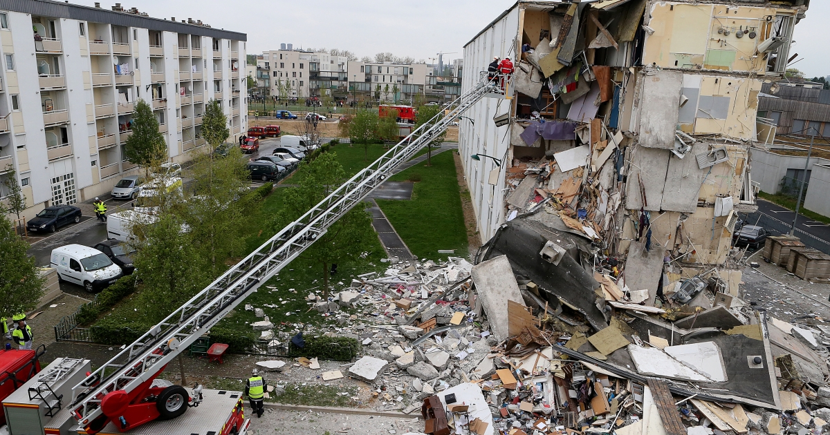 Firemen are at work near the collapsed section of an apartment building on April 28, 2013 in Reims, eastern France, after a suspected gas explosion killed at least two people and injured nine others leaving people trapped under debris, authorities said.</p>