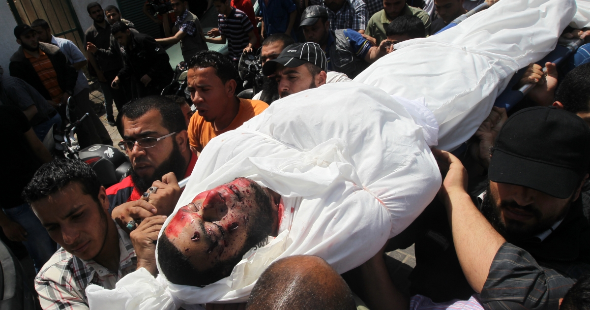 Palestinian mourners carry the body of Haytham al-Meshal, during his funeral in Gaza City, on April 30, 2013. An Israeli air strike on Gaza City killed one person Palestinian officials said, with Israel saying it targeted a militant involved in a rocket attack on Eilat on April 17.</p>