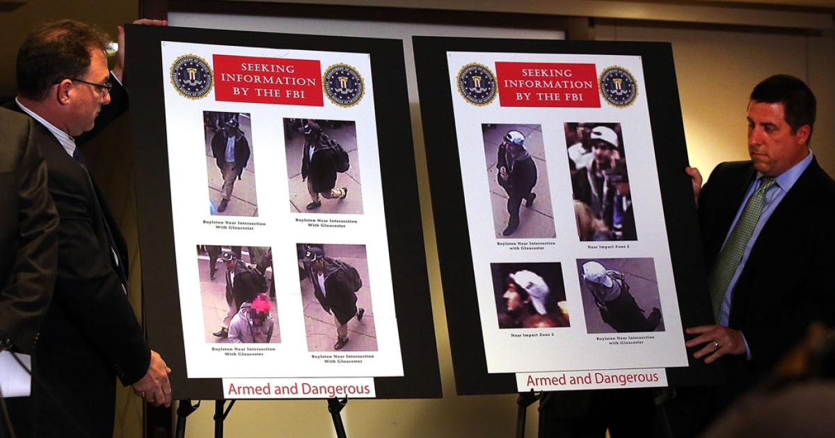 Images taken from a security camera of suspects in the bombings at the Boston Marathon during a news conference on April 18, 2013 in Boston, Massachusetts. They were later identified as Dzhokhar and Tamerlan Tsarnaev. Tamerlan died in a shoot-out with police, while Dzhokhar is in custody.</p>