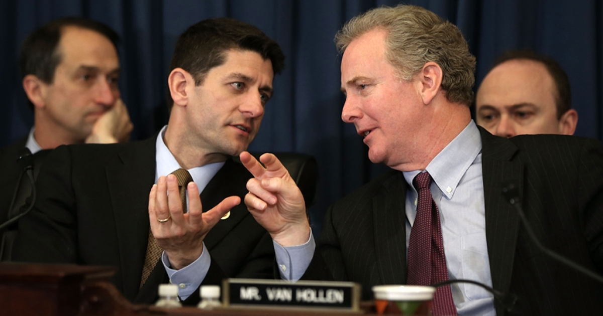 Committee chairman U.S. Rep. Paul Ryan (R-WI) (L) speaks as ranking member Rep. Chris Van Hollen (D-MD) (R) listens during a hearing before the House Budget Committee April 16, 2013 on Capitol Hill in Washington, DC.</p>