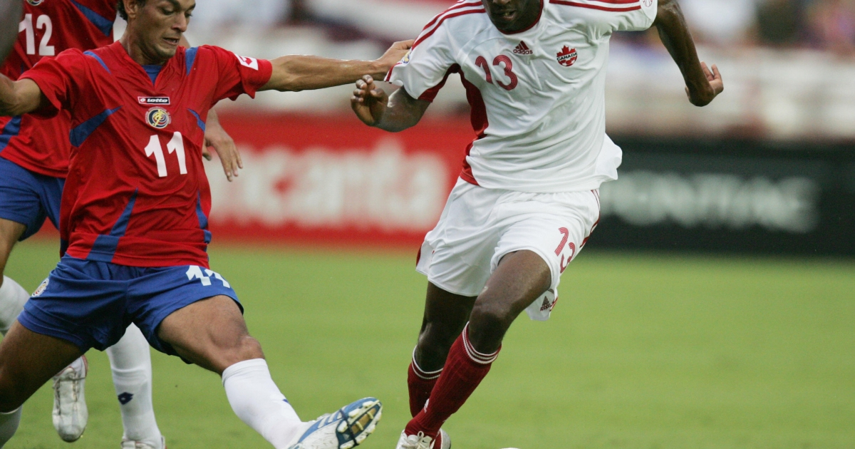 Atiba Hutchinson of Canada (R) dribbles past Michael Barrentos of Costa Rica (L) in their CONCACAF Gold Cup 2007 first round match at the Orange Bowl Stadium in Miami, Florida 06 June 2007.</p>