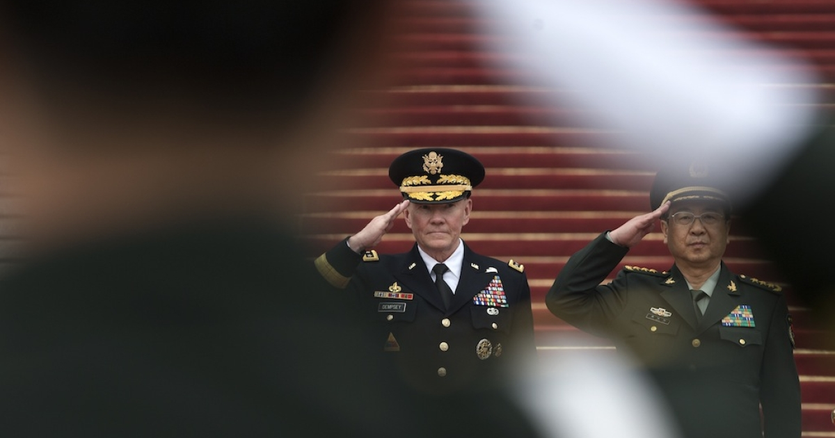 Joint Chiefs Chairman Gen. Martin Dempsey (L) and Chinese counterpart Gen. Fang Fenghui salute during a welcoming ceremony at the Bayi Building on April 22, 2013 in Beijing, China.</p>