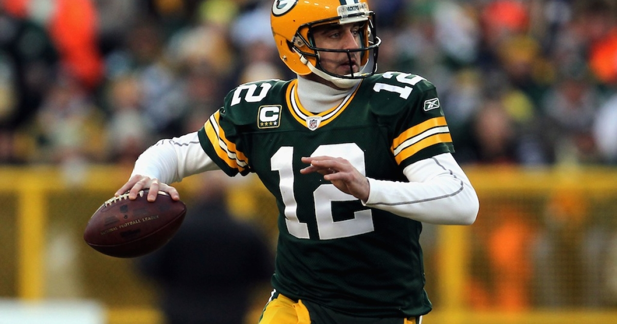 Aaron Rodgers #12 of the Green Bay Packers looks to pass against the New York Giants on Jan. 15, 2012 in Green Bay, Wisconsin.</p>