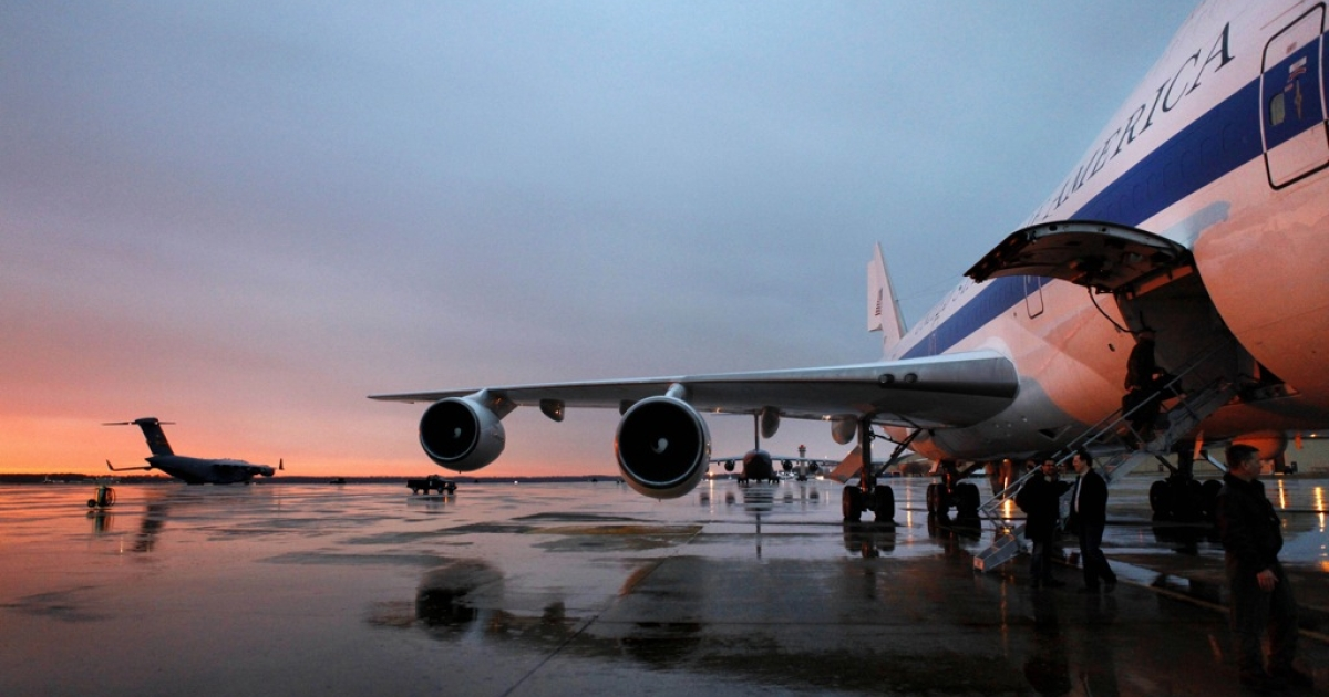The crew of the E-4B, the plane for the US Secretary of Defense, waits for the Secretary to arrive at sunrise to leave for a NATO conference in Brussels, Belgium on Feb. 1, 2012 from Andrews Air Force Base, Maryland.</p>