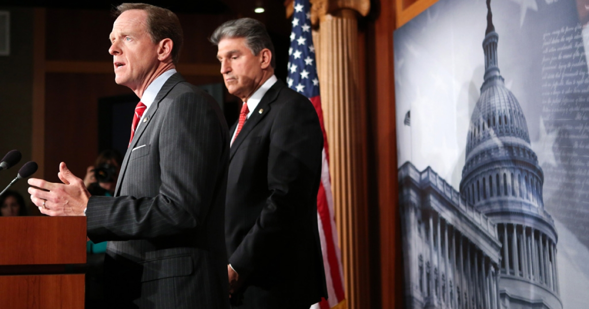 From left, Sen. Pat Toomey (R-Pa.) and Sen. Joe Manchin (D-WV) speak to press about background checks for gun purchases on April 10, 2013 in Washington DC. The pair is proposing a bipartisan compromise, a proposal to be voted on as an amendment that would expand background checks to firearms sales at gun shows and on the Internet.</p>