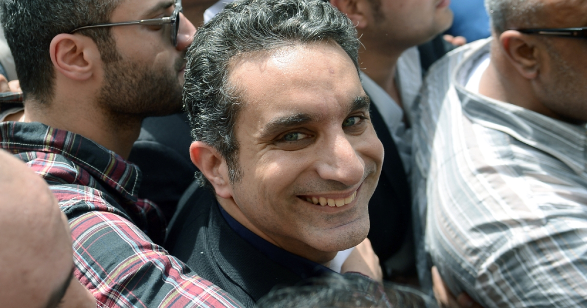 Egyptian satirist and television host Bassem Youssef is surrounded by his supporters upon his arrival at the public prosecutor's office in the high court in Cairo, on March 31, 2013.</p>