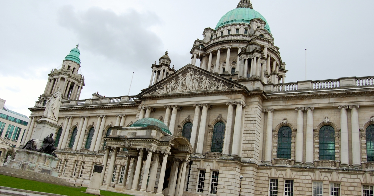 The decision to reduce the number of days the Union Jack flies above Belfast City Hall has reopened old wounds.</p>