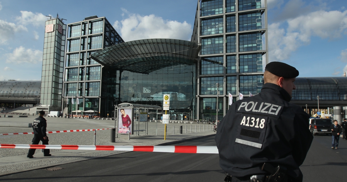 Police outside Berlin's Hauptbahnhof in September 2012. The city's main train station suffered disruption as police defused a nearby bomb left over from World War II on April 4, 2013.</p>
