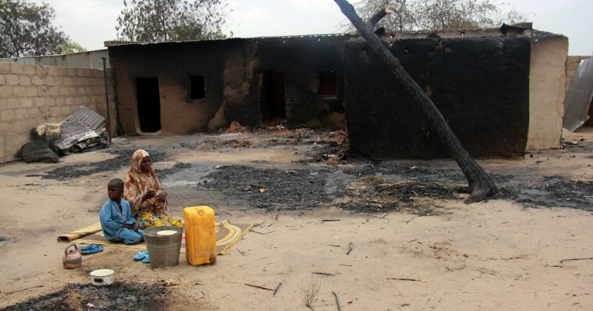 Children sit in front of a burnt house in the remote northeast town of Baga on April 21, 2013 after two days of clashes between officers of the Joint Task Force and members of the Islamist sect Boko Haram on April 19 in the town near Lake Chad, 200 kms north of Maiduguri, in Borno State. Nigerian rescue workers set up temporary camps in Baga on April 25 and distributed aid to the masses displaced by brutal fighting that left 187 people dead. The bloodshed in Baga likely marked the deadliest-ever episode in the insurgency of Boko Haram, a radical group which has said it wants to create an Islamic state in northern Nigeria.</p>