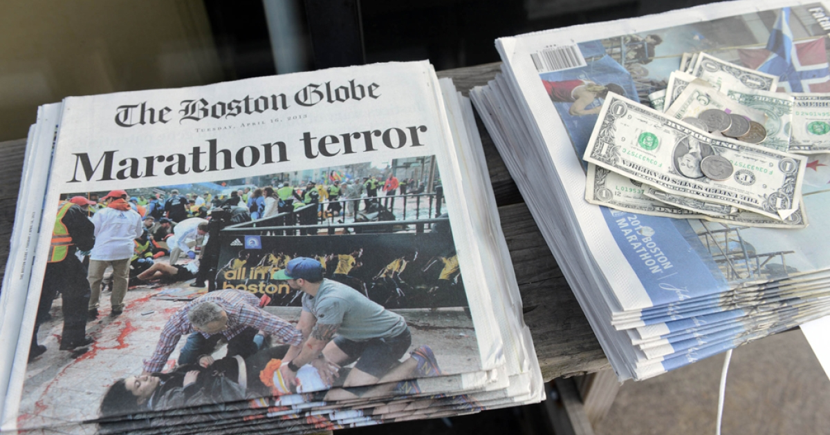 Newspapers on sale at a stand on Newbury Street on April 16, 2013 in Boston.</p>