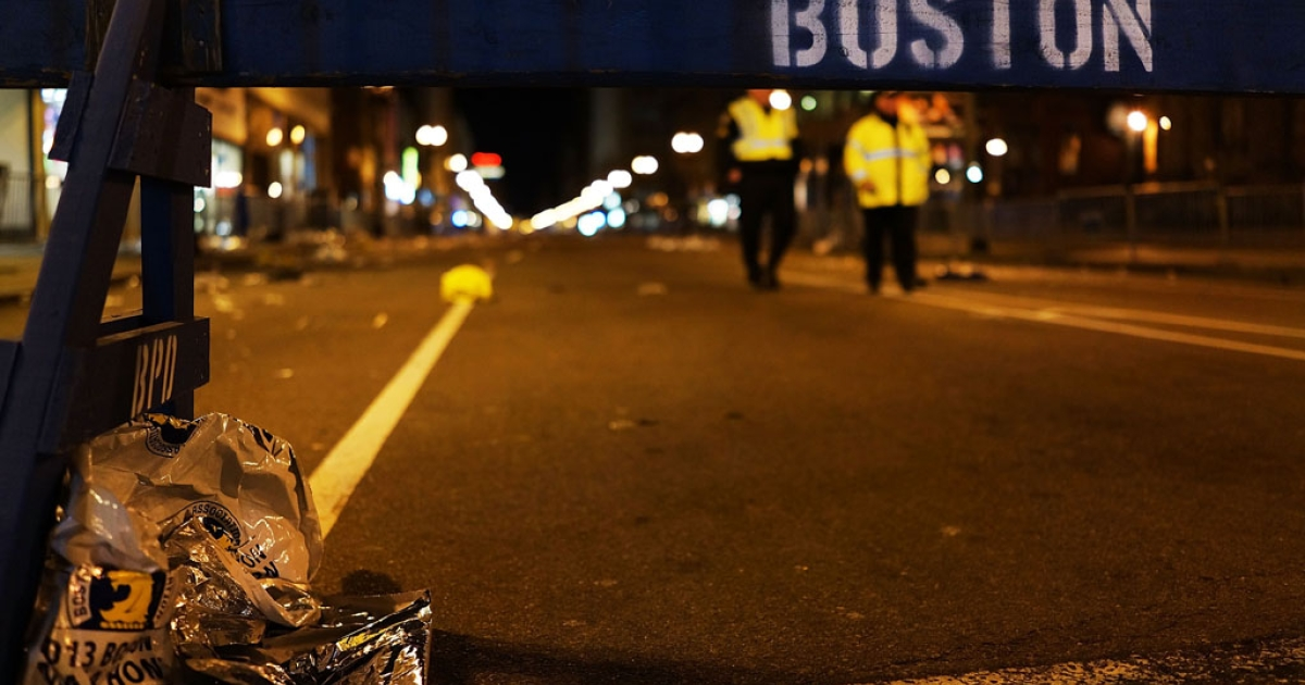 A piece of debris rests against a police barricade near the scene of Monday's deadly bombing at the finish line of the Boston Marathon. FBI investigators will try to rebuild the bombs used in the attack to determine their origin.</p>
