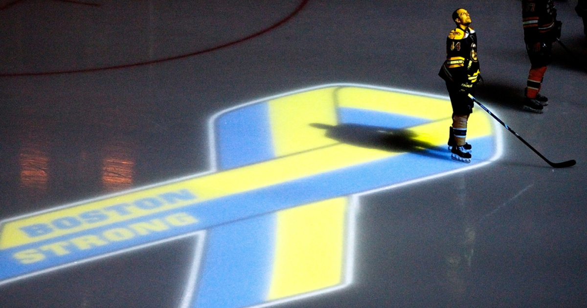Boston Bruins' Dennis Seidenberg stands during pre-game ceremonies in remembrance of the Boston Marathon bombing victims before an NHL game againt the Buffalo Sabres at TD Garden on April 17, 2013 in Boston.</p>