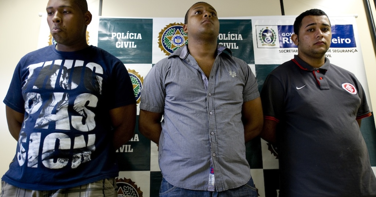 (L-R) Wallace Aparecido Silva, Carlos Armando Costa dos Santos and Jonathan Froudakis de Souza, who allegedly raped a foreign tourist in a van in Rio de Janeiro on March 30, 2013 are presented to the press in Rio on April 2, 2013. The three are accused of the rape of an American student who was assaulted as her French boyfriend was forced to look on during a horrific six-hour abduction aboard a Rio public transportation van, local media reported.</p>