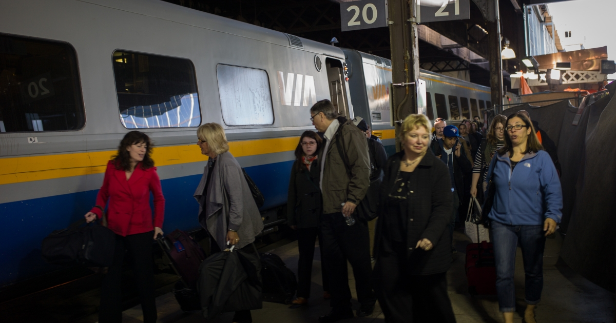Commuters leave a VIA Rail train at Union Station, the heart of VIA Rail travel, on April 22, 2013 in Toronto, Ontario, Canada. The Royal Canadian Mounted Police (RCMP) report they have arrested two people connected to an alleged Al Qaeda plot to detonate a bomb on a VIA Rail train in Canada.</p>