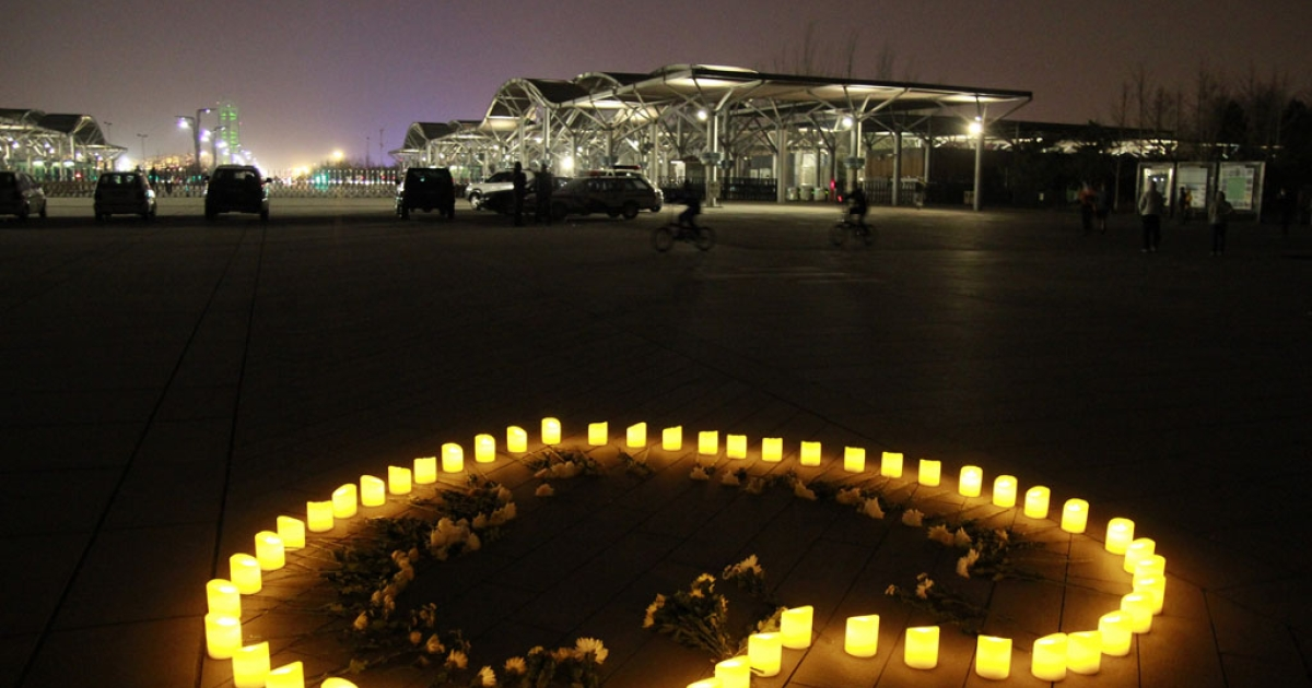 Chinese people light candles to mourn for the victims of the Boston Marathon explosion at Olympic Forest Park on April 16, 2013 in Beijing, China.</p>