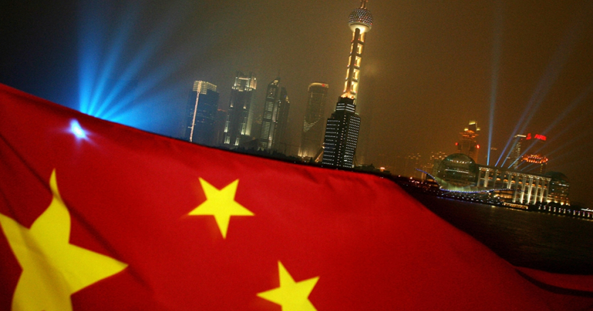 The Chinese flag flies in front of the Pudong skyline in Shanghai, Jun. 14 2006.</p>