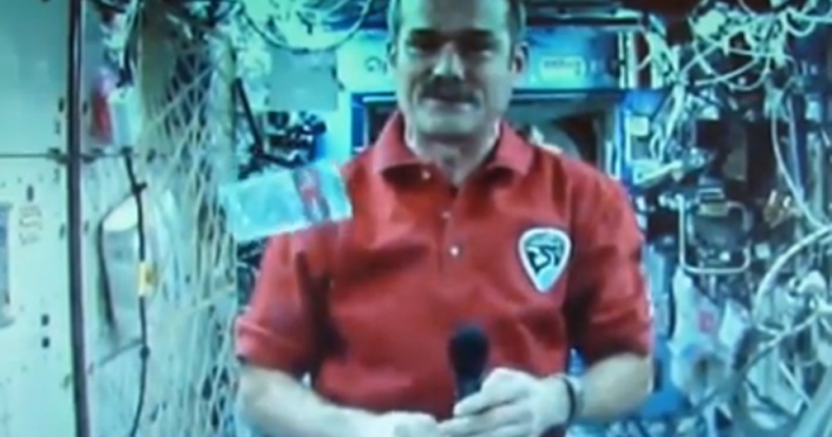 Astronaut Chris Hadfield reveals the new Canadian $5 bill during a publicity event aboard the International Space Station on April 30, 2013. The $5 and $10 bills are made from polymers instead of paper.</p>