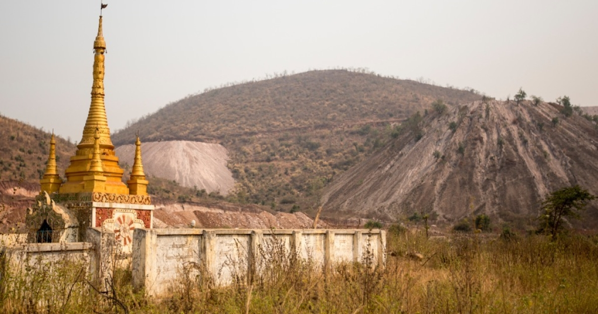 Large piles of dirt extracted from mining sites around Letpadaung Mountain encroach on a pagoda near Ah Lay Daw village. Many of the monks burned on November 29, 2012 were protesting the mine's encroachment on a historical Bhuddist monastery within the mine's grounds.</p>