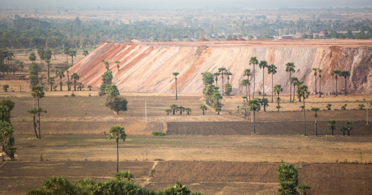 Enormous piles of top soil can be seen throughout the valley surrounding Myanmar's largest mine. The dirt has been excavated from the mine site in order to reach the large deposit of copper under the ground. Locals say the piles are pushing great amounts of dust into the air and subsequently causing respiratory problems.</p>