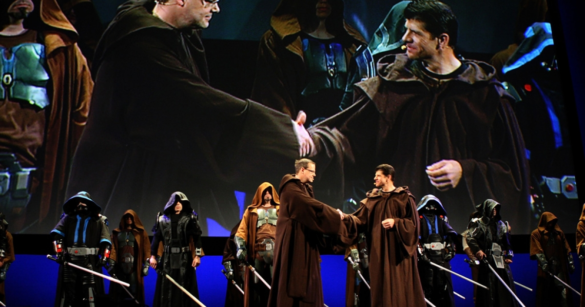BioWave co-founder Dr. Ray Muzyka, left, and LucasArts president Darrell Rodriguez join characters wearing robes and wielding lightsabers on stage to promote their joint effort, Star Wars: The Old Republic, on June 1, 2009 in Los Angeles, California during the E3 Expo.</p>