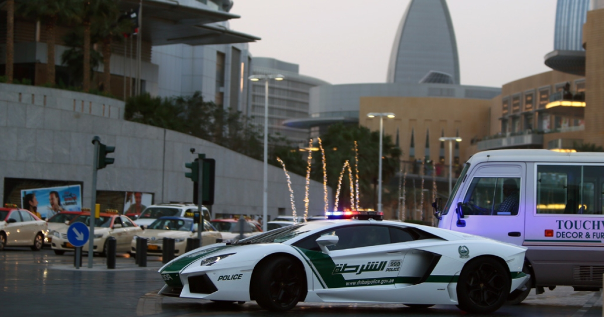 Emirati policemen patrol in a Lamborghini Aventador near Burj Khalifa in the Gulf emriate of Dubai on April 12, 2013. A sleek $550,000 Lamborghini Aventador, which can reach speeds of up to 217 mph, has joined the city's fleet of patrol cars to enhance the glizty Gulf emirate's trademark image of luxury and prosperity.</p>