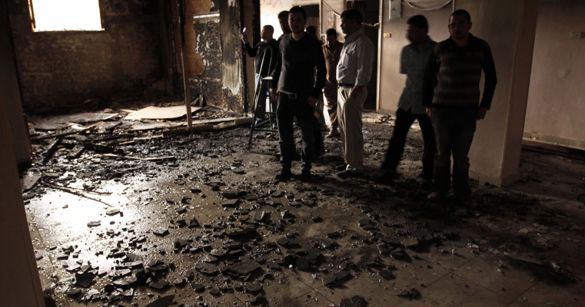 People inspect damage after a night of sectarian clashes between Christians and Muslims in Al-Khusus, a poor area in Qalyubia governorate, north of Cairo on April 6, 2013.</p>