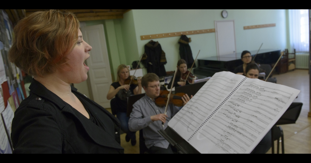 Singer Iris Oja performs with members of Estonia's Tallinn Chamber Orchestra during a rehearsal of the opera