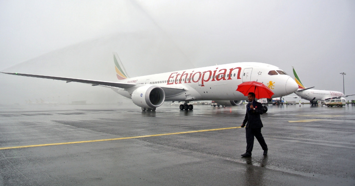 A Boeing 787 Dreamliner is hosed down on arrival in Addis Ababa on August 17, 2012.</p>