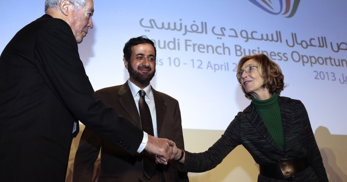 French Minister for Foreign Trade Nicole Bricq (R) shakes hands with head of French employers association MEDEF International, Jean Burelle (L), beside Saudi Arabia's Minister of Commerce and Industry Tawfig Al Rabiah (C) on April 11, 2013 at the opening of the 'Saudi French opportunity' forum in Paris.</p>