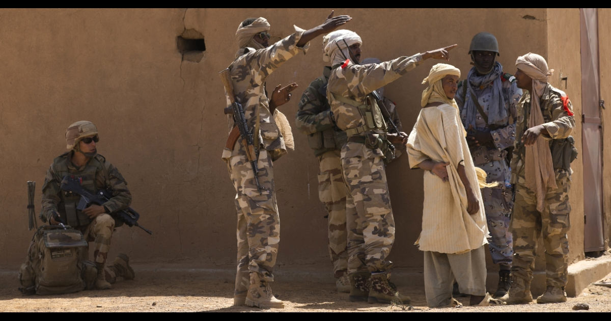 A Malian Special Force soldier and a French soldier question people during the Operation Gustav, a hunt for Islamist fighters in a valley in northern Mali and one of France's largest military operations during its three-month intervention in its former colony, on April 9, 2013.</p>