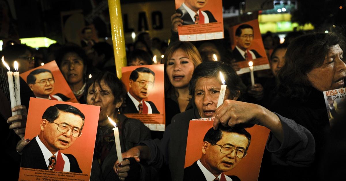 Supporters of former Peruvian President Alberto Fujimori hold a vigil for the imprisoned ex-leader.</p>