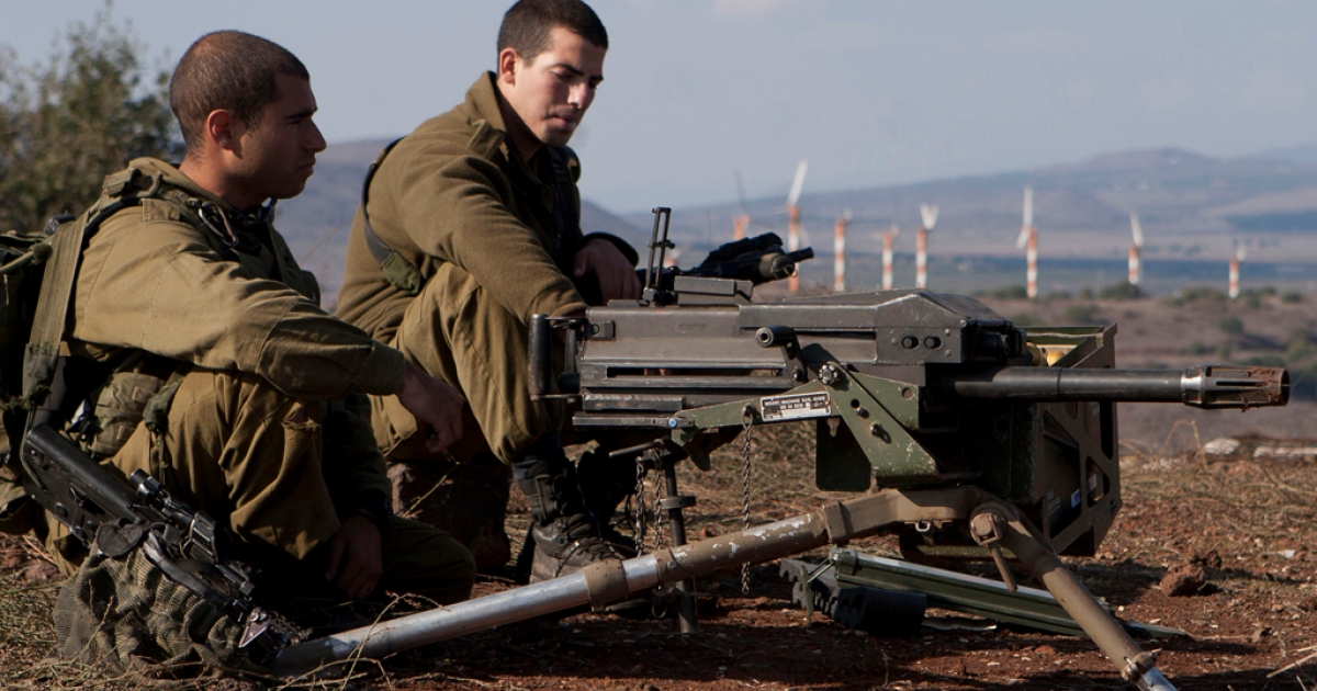 Israeli soldiers overlooking the ceasefire line between Israel and Syria in the Golan Heights.</p>