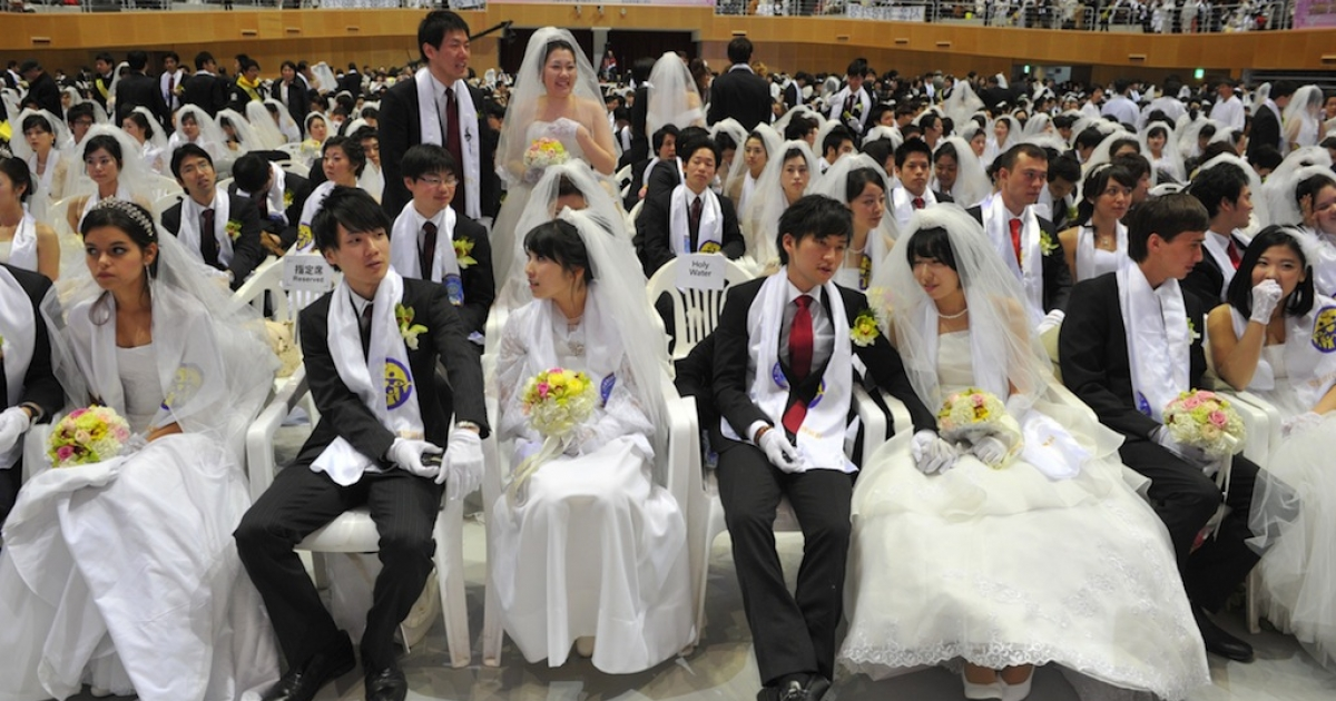 Newly-married couples sit down at the Unification Church's mass wedding held at the church's headquarters in Gapyeong, east of Seoul, on February 17, 2013. The Bank of Korea announced it was opening its auditorium up for weddings starting in May.</p>