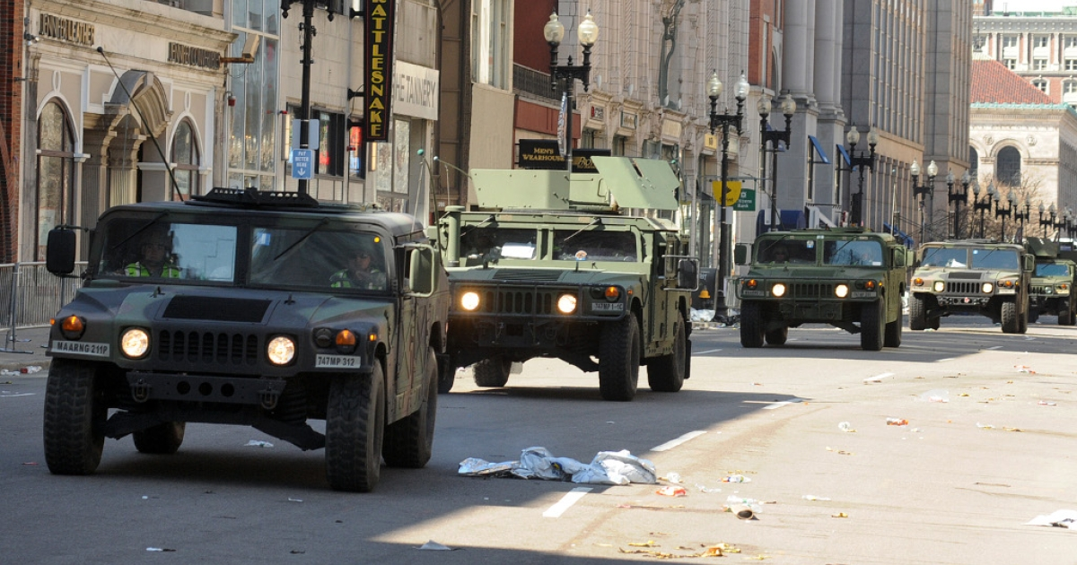 US military Humvees rolling down a deserted Boylston Street April 16, 2013, which is considered a crime scene after two explosions rocked the Boston Marathon on Monday. There are no known additional threats following the bombing at the Boston marathon that killed three people and wounded more than 150, an FBI official said Tuesday.</p>