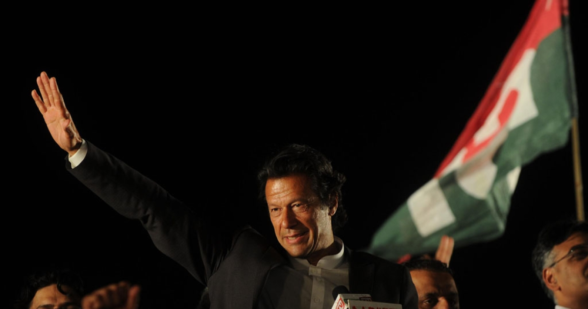Former cricketer and chairman of Pakistan's political party Pakistan Tehreek-e-Insaf Imran Khan gestures as he addressing a public meeting in Lahore on March 23, 2013. Cricket legend Imran Khan is expected to unveil his manifesto to become Pakistan's next prime minister at an election rally on Saturday, where turnout will be a key test for his chances of success.</p>