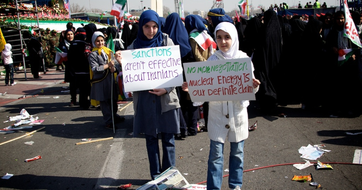 Iranian school girls pose with banners supporting Iran's nuclear program during a rally in Tehran's Azadi Square on Feb. 10, 2013.</p>