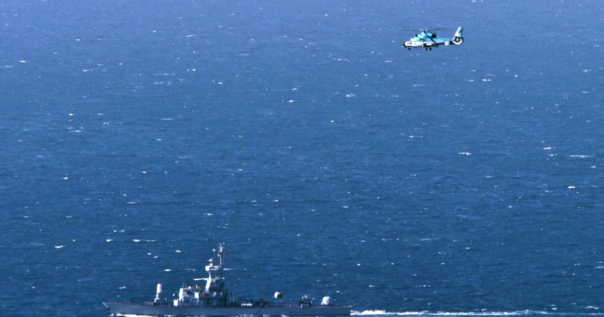 An Israeli navy vessel and helicopter search for the wreckage of a drone which was shot down by the air force off Israel's northern coast on April 25, 2013.</p>