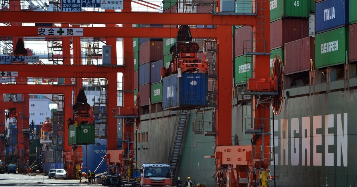 Containers are unloaded from an international freighter at the international cargo terminal in Tokyo on March 21, 2013. Japan logged a trade deficit of 8.1 billion USD in February, reversing a year-earlier surplus as a weaker yen pushed import costs up.</p>