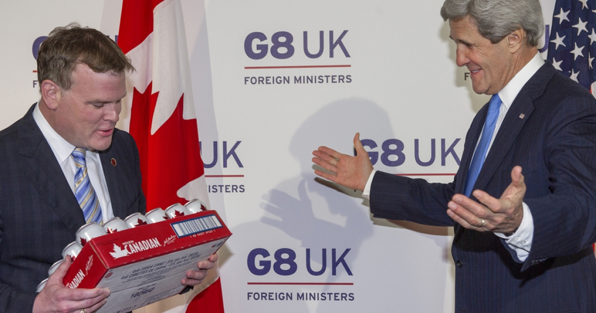 Canadian Foreign Minister John Baird, left, presents US Secretary of State John Kerry with a case of Molson Canadian beer on the sidelines of the G8 Foreign Ministers meeting at Lancaster House in London on April 11, 2013, to pay off a gentlemen's bet on the women's ice hockey championship between Canada and the US. The US won 3-2.</p>