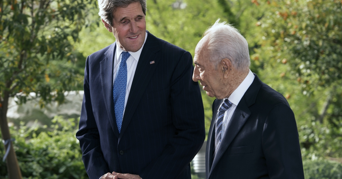 US Secretary of State John Kerry, left, talks with Israeli President Shimon Peres before the start of a private meeting.</p>