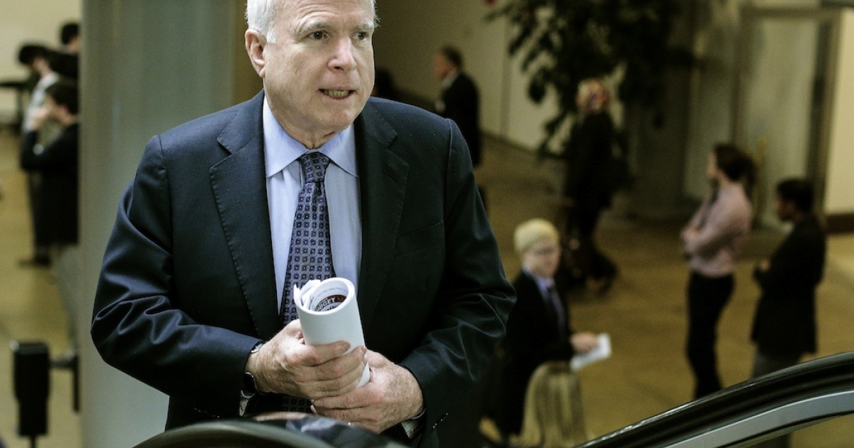 U.S. Sen. John McCain talks with reporters on his way to the weekly Senate Republicans policy luncheon on March 19, 2013 in Washington, DC.</p>